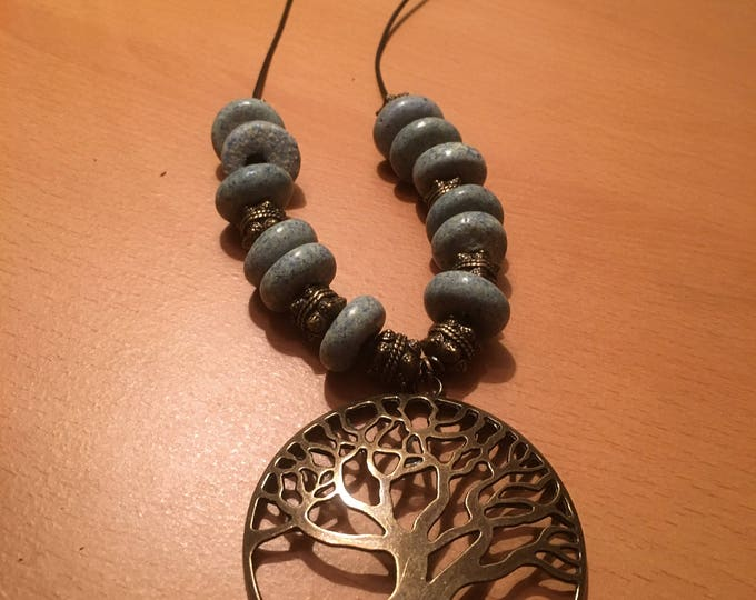 Handmade beaded necklace, A tree pendant on a black leather strand with metal and blue beads