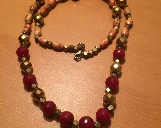 Handmade beaded necklace, depicts cultural fusion, made of red colored, metal and wooden beads