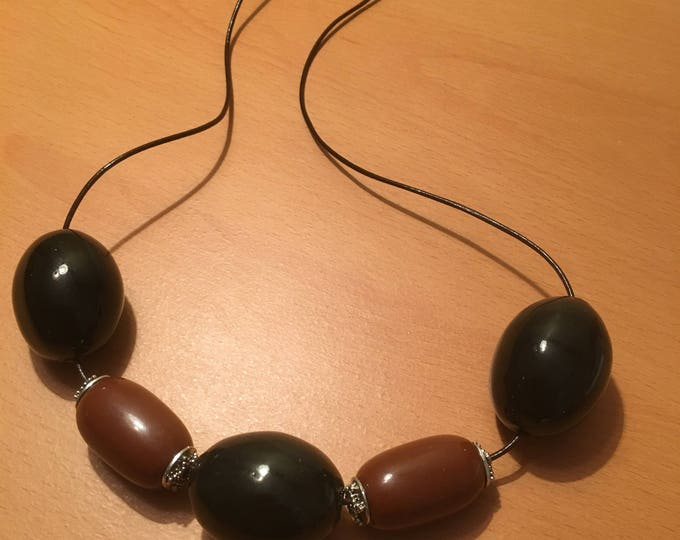 Handmade beaded necklace, An exotic earth colored necklace made of Large black and silver toned brown exotic beads on a black leather chord