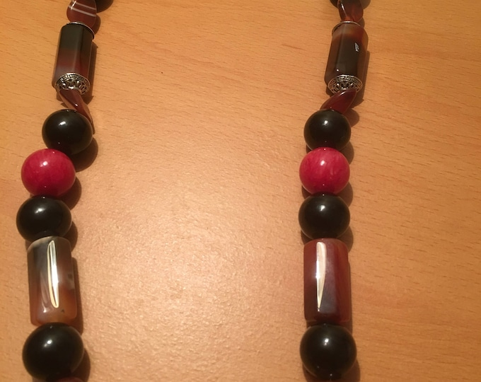 handmade beaded necklace with predominantly red and black beads