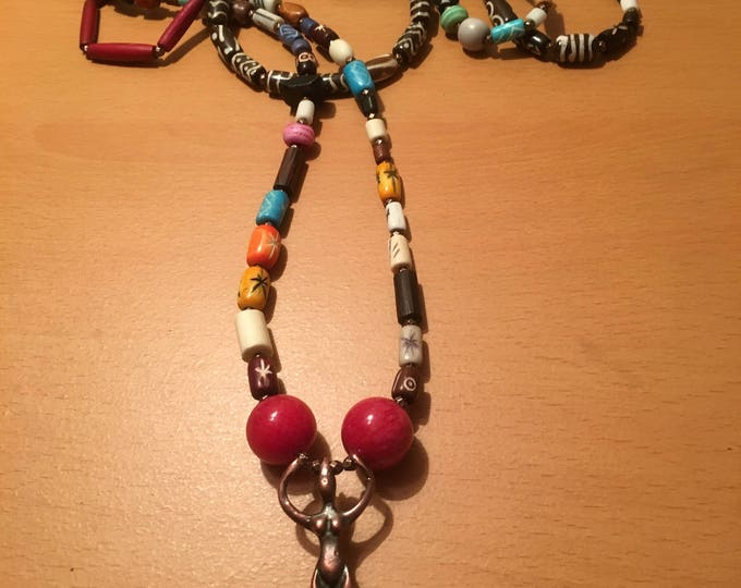 Handmade triple wind necklace with multicolored and mixed beads with a pendant.