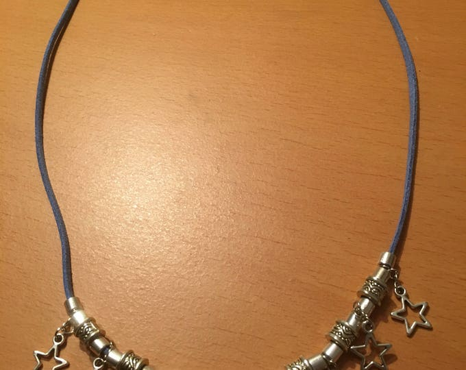 Handmade beaded necklace made of metal beads and charms on a blue faux leather chord