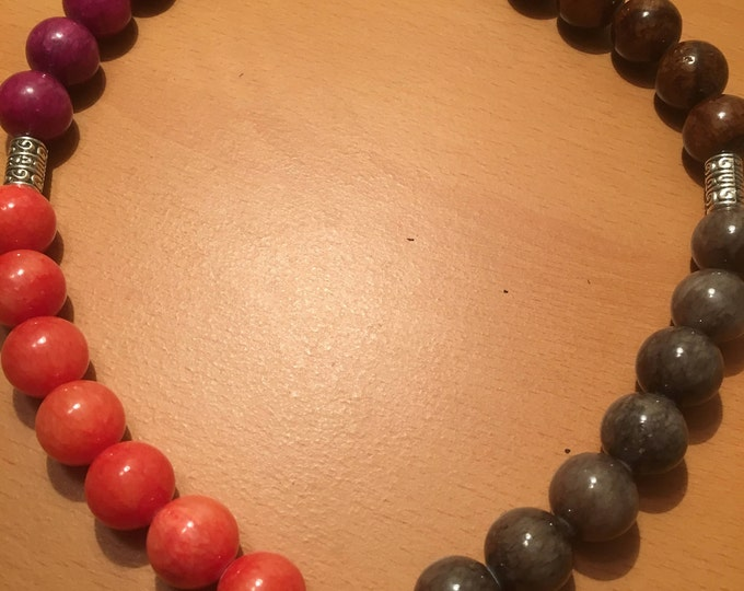 Handmade beaded necklace made of Orange, brown, pink and gray beads