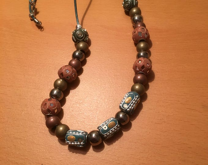 A bead phenomenon! A beaded necklace withe exotic beads on a blue leather chord