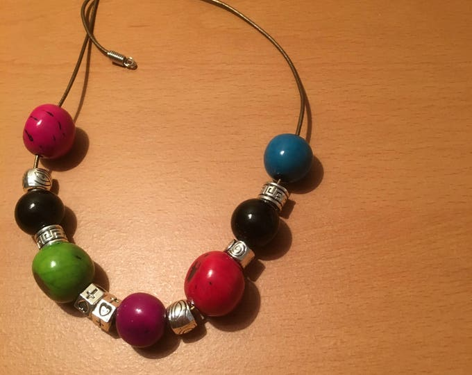 Handmade beaded necklace with the message of 'equity in beauty' . Odd is beautiful...! made of multicolored and metal beads