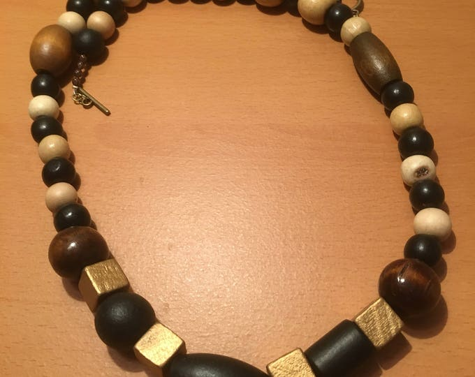 Handmade beaded necklace made of multisized and beads of varying earth colors