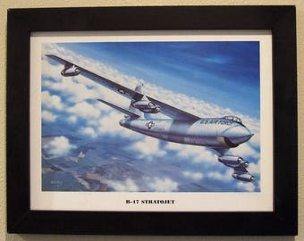"""This 14 1/2"""" X 18 1/2"""" Black Framed artprint (12"""" X 16"""" image size) is of a Boeing B-47 Stratojet climbing to a higher altitude!"""