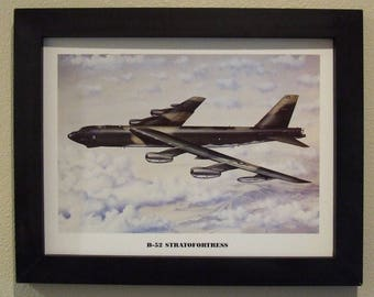 """14 1/2"""" X 18 1/2"""" Black Framed Artprint ( 12"""" X 16"""" image size) of a Boeing B-52 Stratofortress over the sands of Iraq during Desert Storm."""