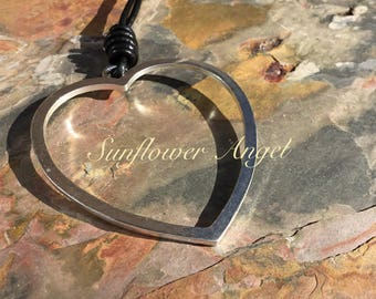 Large heart shaped pendant, with leather thread necklace.