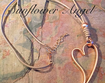 Frosted gold wide edge teardrop heart pendant, on thick leather mink thread. Heart, frosted, necklace, leather thread.
