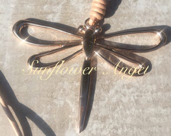 Large dragonfly pendant on long leather necklace thread, in 2 colours. Rose gold, with mink thread, or silver with black thread.