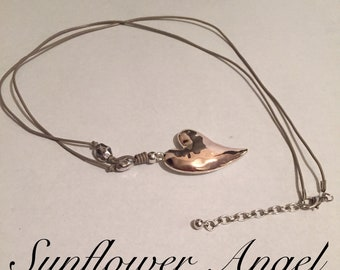 Abstract two tone double sided heart necklace, with mink leather strand necklace