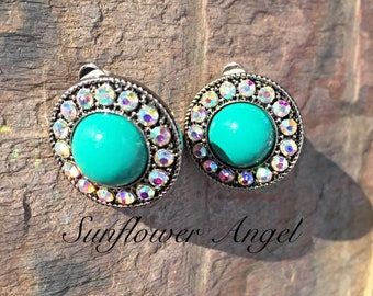 Clip on Earrings, with acrylic turquoise centre and surrounded with diamanté.