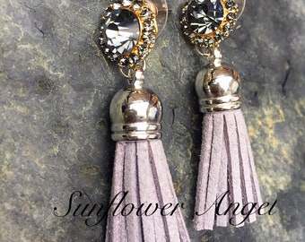 Glamourous grey crystal earrings, with a suedette tassel. For pierced ears.