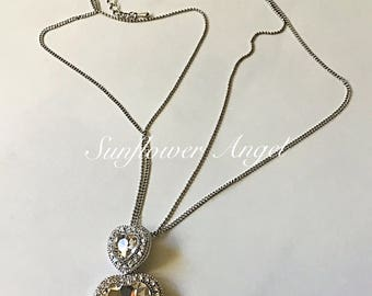 Stunning silver and diamante heart necklace and earring set, perfect for a wedding.