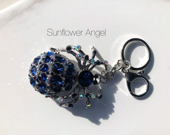 Amazing Vintage style silver glamourous spider keyring or handbag charm. With blue crystals.
