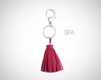 Chunky mini suede and leather, tassel keyring, keycharm, handbag charm. In 2 colours, cerise or teal.