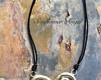 Lagenlook short necklace with frosted stretched heart on double leather thread with extension chain