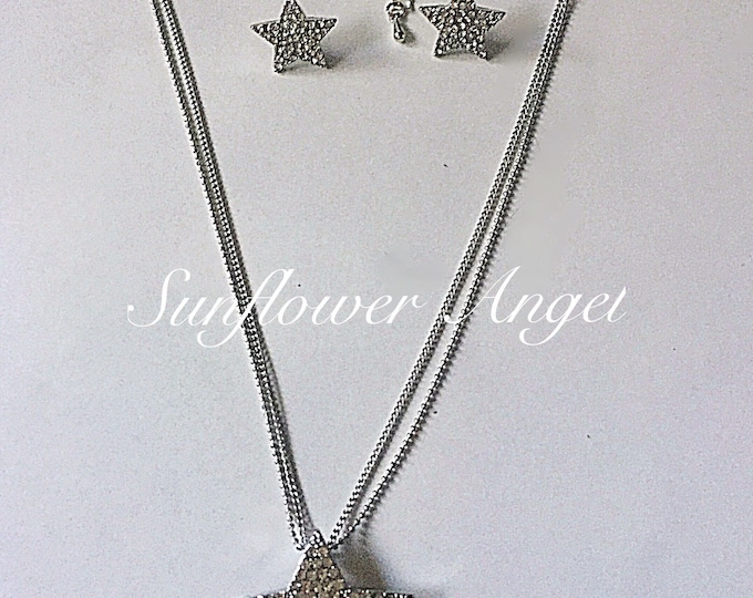 Featured listing image: Stunning silver and diamante star necklace and earring set, perfect for a wedding or party.