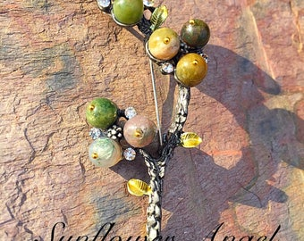 Pewter, gunmetal branch, tree brooch, with beaded berries, also pendant loop for a necklace.