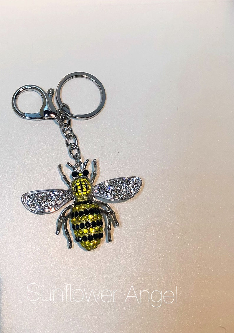 in silver with ring and bag clip. Large bumble Queen bee diamante keyring or bag charm