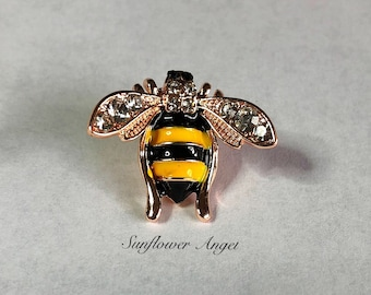 Bee pin, decorated with enamel and diamante, with squeeze pin closurer.