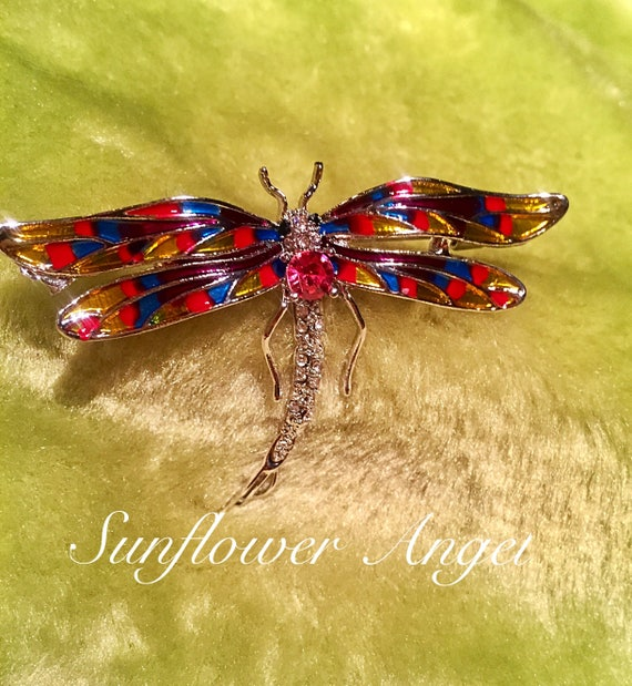 Dragonfly diamante brooch, stunning sparkles in this art deco style brooch, with multi coloured enamel wings, sent out in a gift boxed.