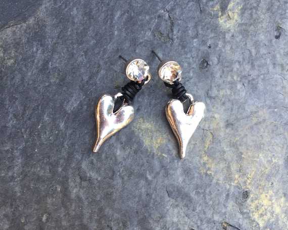 Earrings, with diamante stud, with streatched heart, joining with black leather wrap around