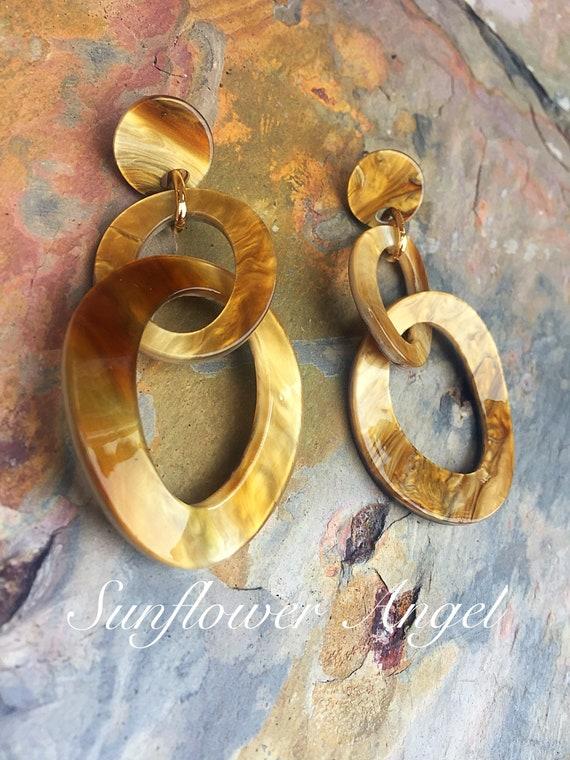 Acrylic, honey earrings. In marble shimmer effect, studs for pierced ears.