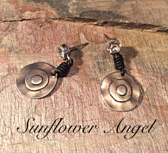 Earrings, with diamante stud, with metal built up disc, joining with black leather wrap around