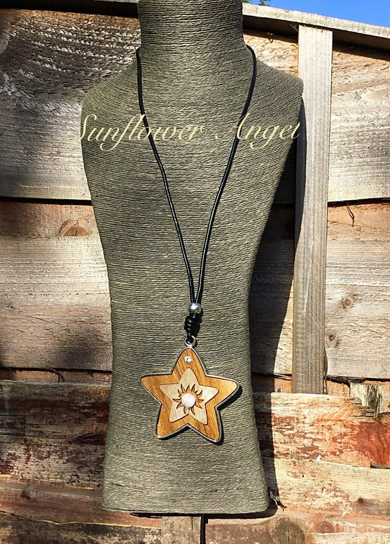 Super, Large wooden star pendant on long black leather thread.