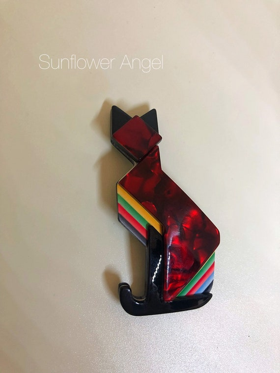 Art deco style, marbled effect acrylic, cat brooch. In red, black and multi coloured.