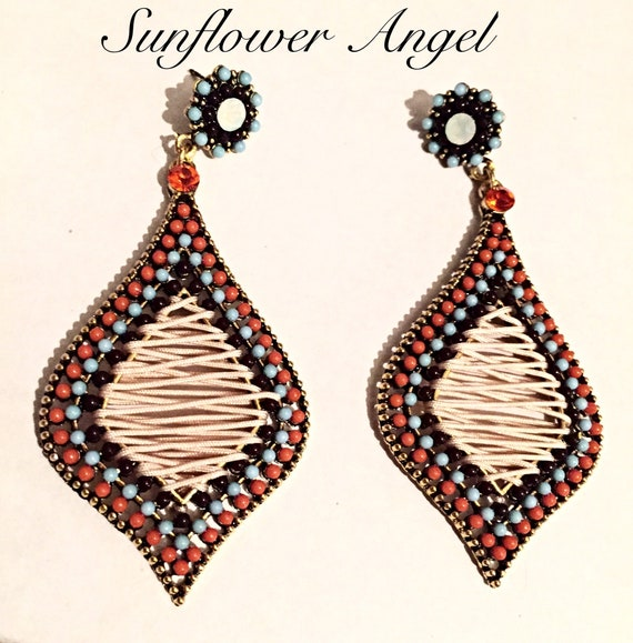 Stunning teardrop persian style earrings, with a beaded surround, and cord centre, on a vintage alloy gold base.