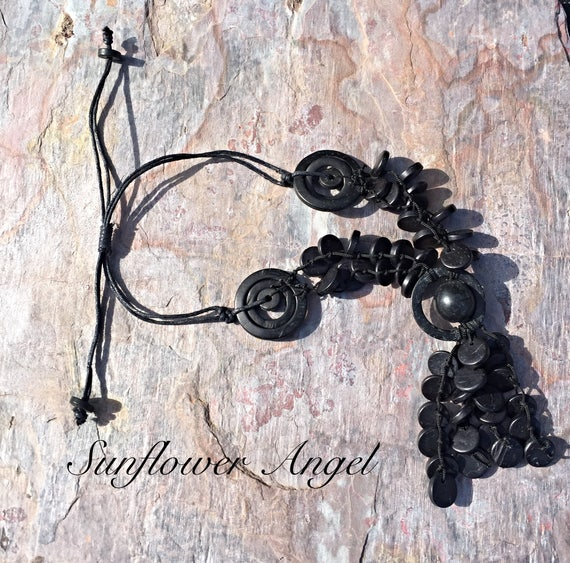 Wooden necklace, Vibrant black Lagenlook Necklace, With coconut shell discs, abstract pieces.