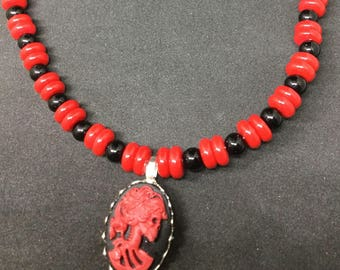 Red and black zombie cameo on a beaded choker necklace