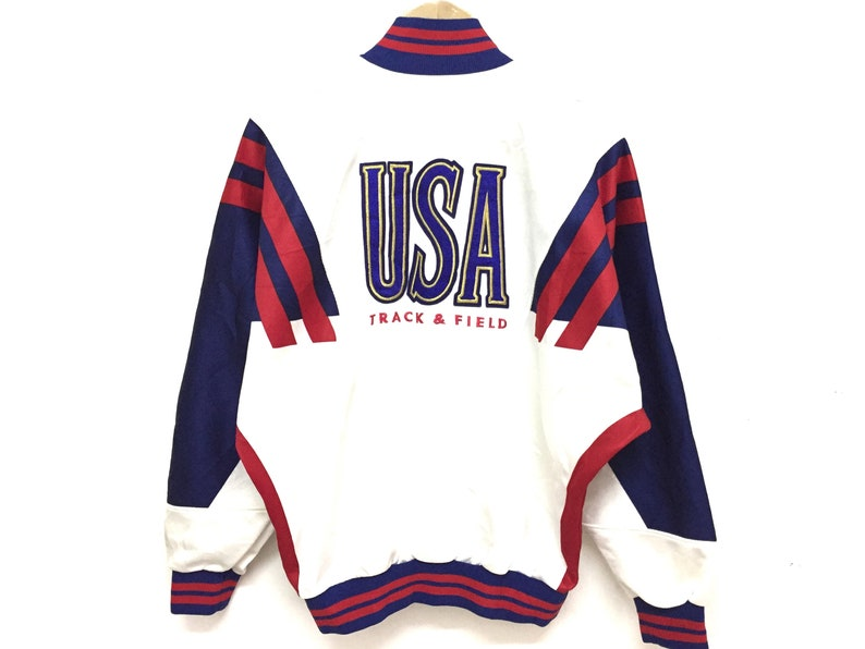 6b75da031fd72 Vintage 90's NIKE Track and Field color Block Sweater gray Tag embroidered  logo Tommy Hilfiger karl kani guess adidas