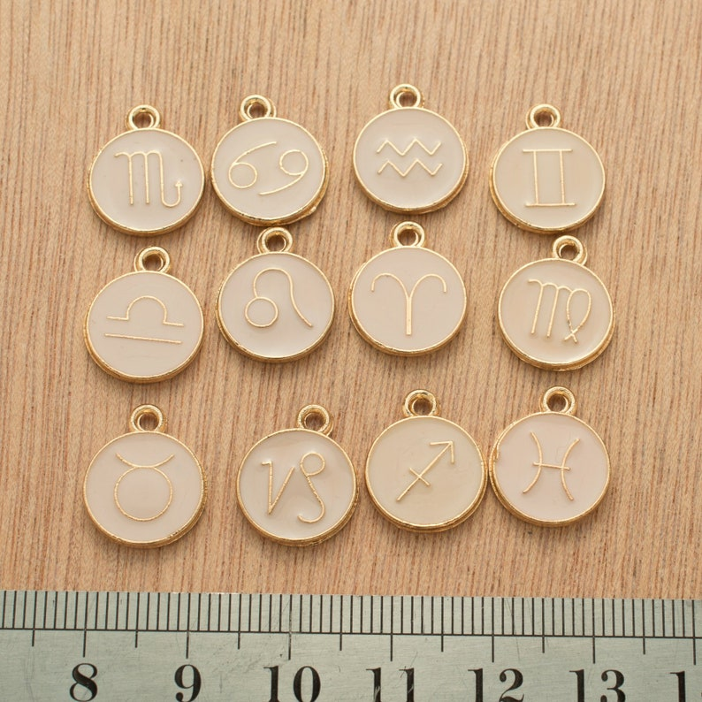 Zodiac small gold charms set of twelve,featuring all star signs.