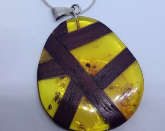 Sterling silver necklace with Amber wrapped pendant
