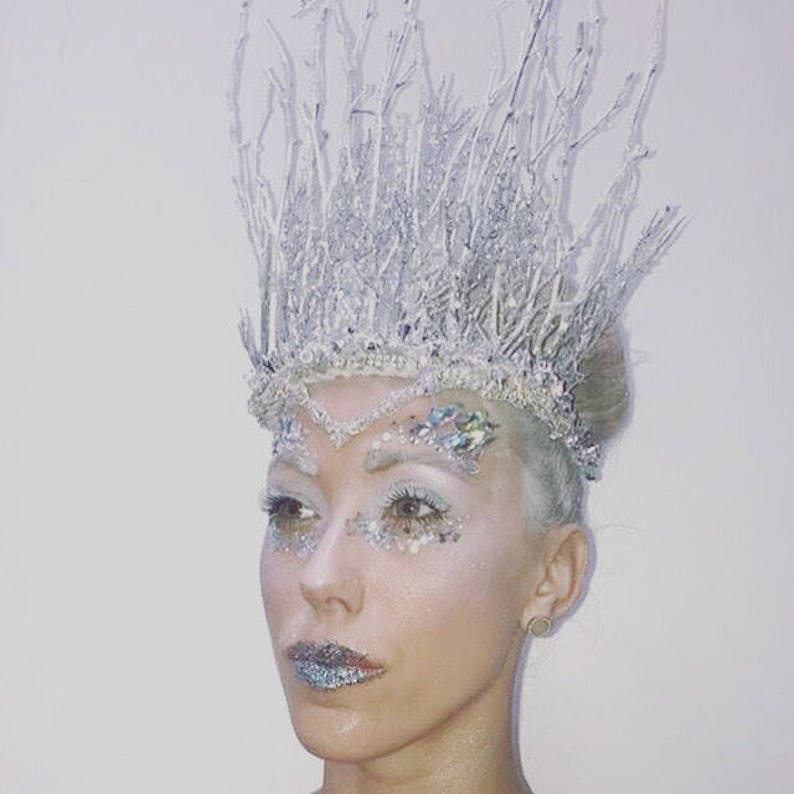 Winter wonderland Ice Queen style over the top crown for your awesome event. Securely & attaches with a skinny elastic strap tucked under the hair at the nape of the neck. Costume Accessory Halloween.