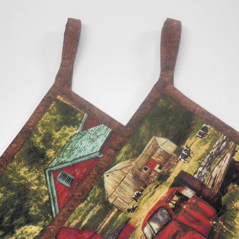 TWO Quilted Fabric Potholders that are 8.5 Square Grain Silo Cow Red Truck Red Tractor Country Kitchen Potholders covered in Red Barns