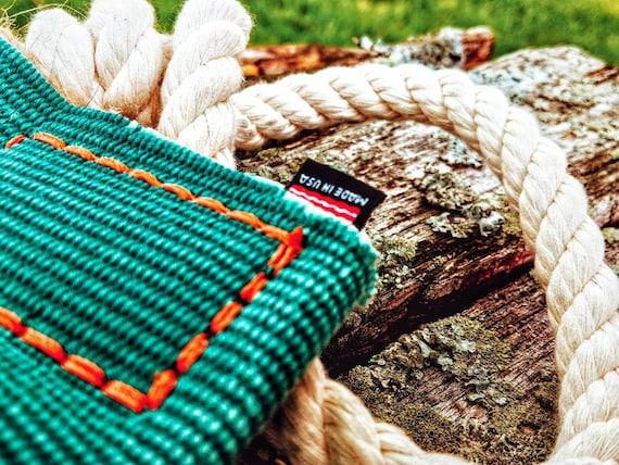 Durable stimulating interactive repurposed firehose rope tug
