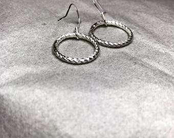 Handmade twisted silver hoops