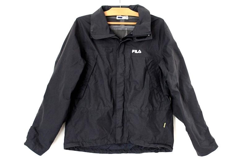 c10f377628b Vintage des années 90 Fila veste veste de Ski noir Fila Fila
