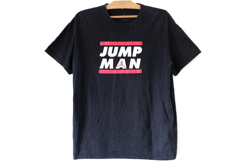 5b36a19a79a5 Vintage Air Jordan Shirt 90 s Air Jordan Jump Man