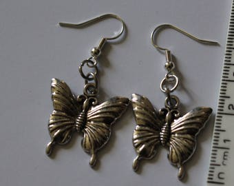 Silver coloured butterfly earrings