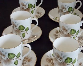 A Set of 6 Mayfair Bone China Coffee Cups and Saucers.