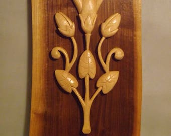 Relief Carving on Walnut for wall mount.