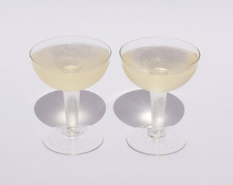 pair of hollow stem coupe glasses