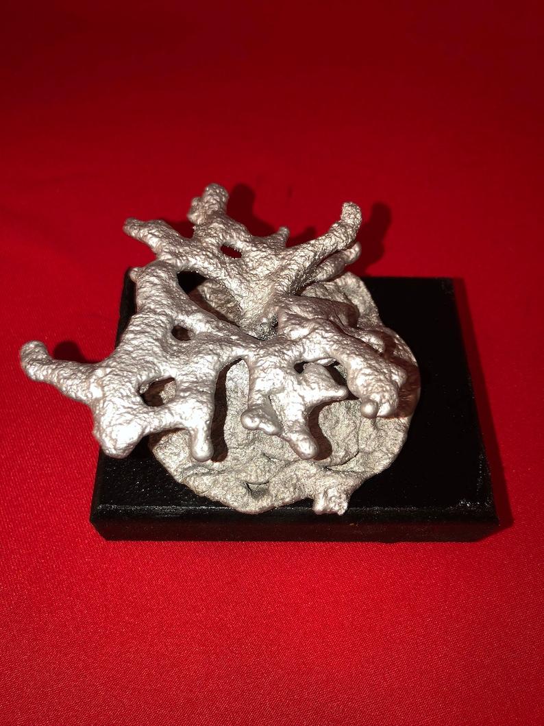 aluminum casting of a pyramid ant colony