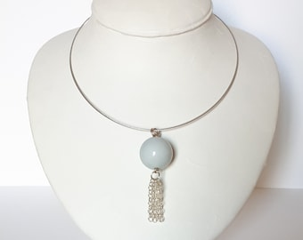 Steel neck with blue pendant